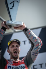 Andrea Dovizioso on the podium after the MotoGP race in Misano