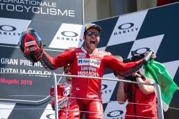 Danilo Petrucci celebrating on podium after MotoGP race in Mugello circuit