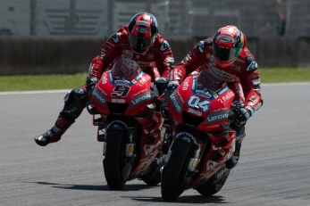Danilo Petrucci overtaking Andrea Dovizioso during MotoGP race in Mugello circuit